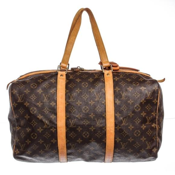 ca8995e67863 Louis Vuitton Handbags - Louis Vuitton Leather Sac Souple 55 cm Duffle Bag